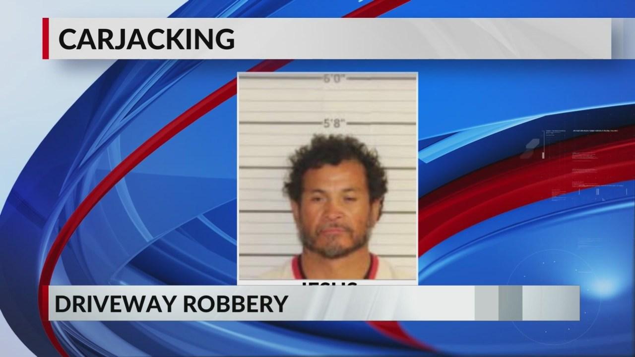 Man carjacked, shot at after pulling into driveway